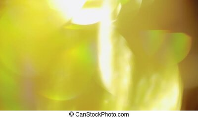 Soft yellow particles in warm hues. Abstract Looping Animated Background.