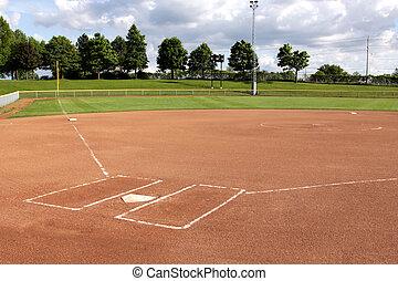 A view of a softball diamond at dusk.