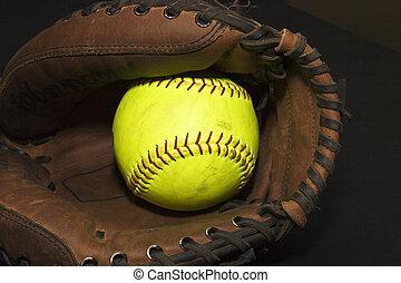 Softball in a Glove - Yellow softball in a catcher\'s glove