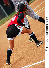 Softball player taking her lead at first base