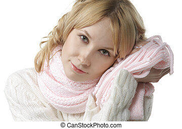 Beautiful woman sensing softnes of pink scarf with cheek