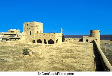 Sohar Fort Oman. castle - Sohar Fort in Oman under blue sky
