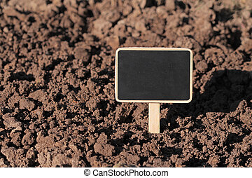 Soil and blank signboard.