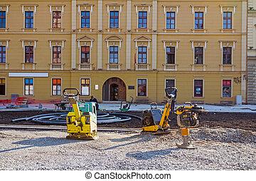 Soil compactor at construction site - Vibrating machine ...