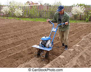 soil cultivation at the small rural farm...
