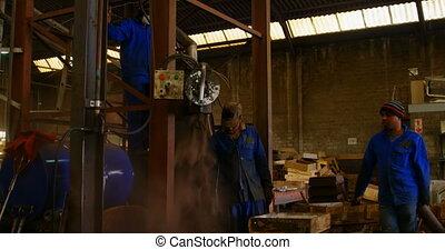 Soil falling through machine in foundry workshop 4k - Soil ...