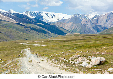 Soil road in high mountains. Tien Shan