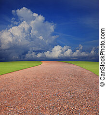 soil road perspective to horizontal with blue sky white clouds