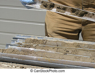 Soil Samples. - The cores from drilling of the earth has to...