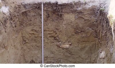 Soil slit close up. Crane shot