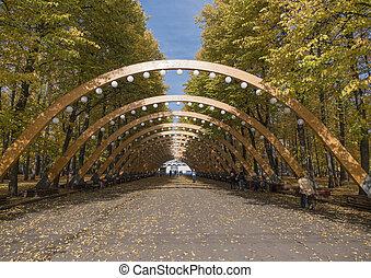 Sokolniki park, sunny autumn day wooden arch.