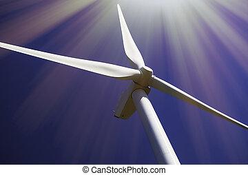 Solar and wind power. Turbine in bright sunshine.