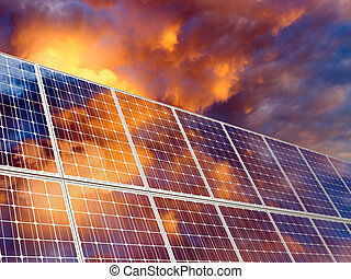 Solar battery on sunset sky background.