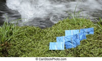 Solar cells on a moss - Six solar cells aligned on a green...
