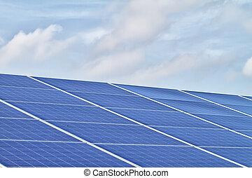 solar cells - blue ecological solar cells and cloudy sky...