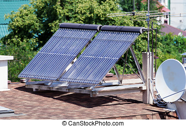 Solar energy collectors for heating the house stands on the roof