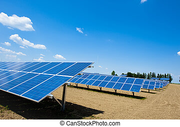 Solar Energy Farm with bright Sky and some Clouds