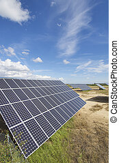 group of photovoltaic panels and sky with clouds