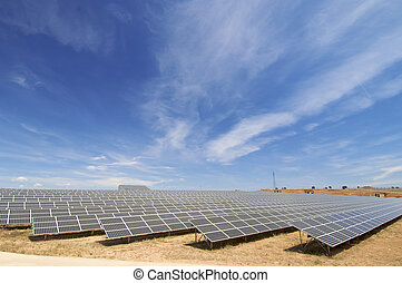 huge solar field with cloudy sky