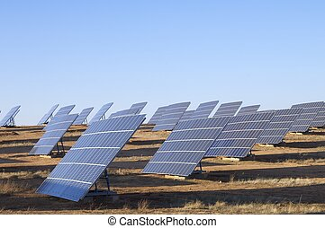 solar energy - group of large photovoltaic panels with clear...