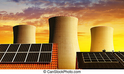 Solar energy panel on the roof of the house in the background cooling towers of nuclear power plant.