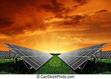 Solar energy panels in the setting sun
