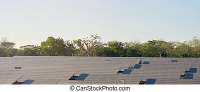 Solar energy panels on blue sky background
