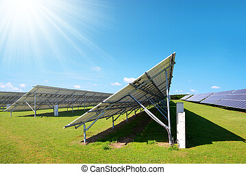 Solar energy panels on the meadow in sunny day.