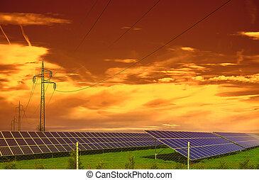 Solar energy panels on the summer meadow