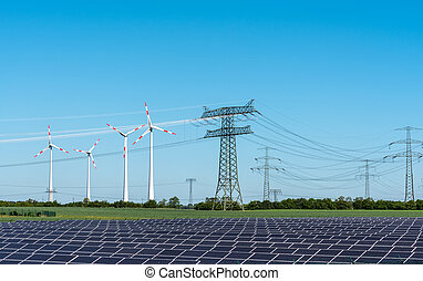 Solar energy panels, wind power and electricity pylons