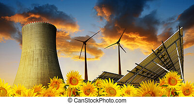 Solar energy panels with wind turbines and cooling tower of nuclear power plant .