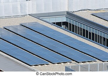 solar energy - aligned group of photovoltaic panels on the...