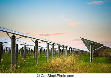 solar farm with sunset glow,  clean energy in autumn