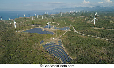 Solar Farm with Windmills. Philippines, Luzon - Aerial view...