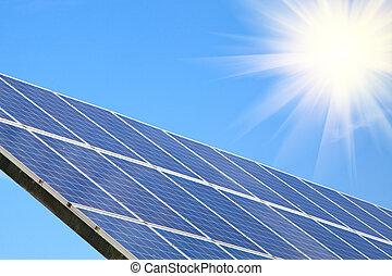 Solar panel against blue sky with sun