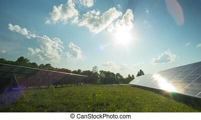 Solar panel and sun, panoramic time-lapse