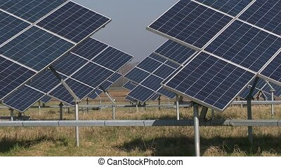 Solar panel battery farm and tractor plow field. Static...