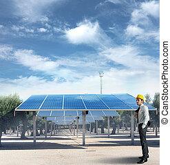 Solar panel - Businessman against an installation of solar...