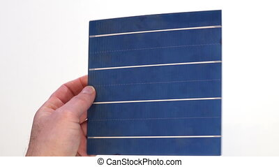 Solar Panel Cell Inspection in One Hand - Close up shot of a...