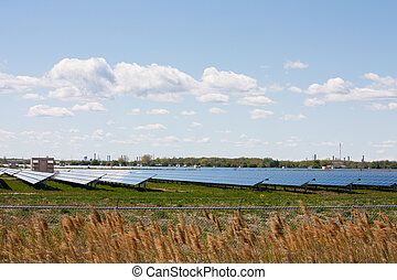 Solar panel farm - Acres of farmland covered with solar...