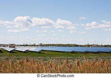 Solar panel farm - Acres of farmland covered with solar...