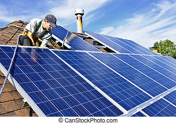 Solar panel installation - Man installing alternative energy...