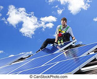 Solar panel installation - Worker installing alternative...