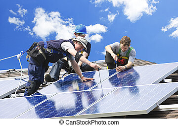 Solar panel installation - Workers installing alternative...