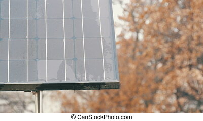 Solar panel on a city street in cloudy weather. Energy...