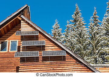 Solar panel on a wooden lodge