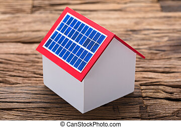 Solar Panel On Model Home At Table