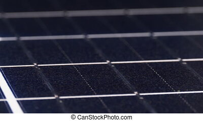 The Solar Panel is Rotated. Monocrystalline Solar Battery. The silicon wafer is spinning. Solar energy. Close-up. surface of Silicon honeycomb solar cell. Green energy. Renewable Sun Energy.