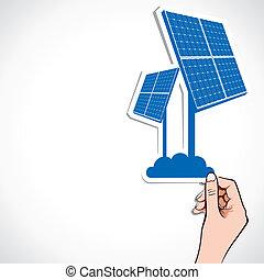 solar panel sticker in hand