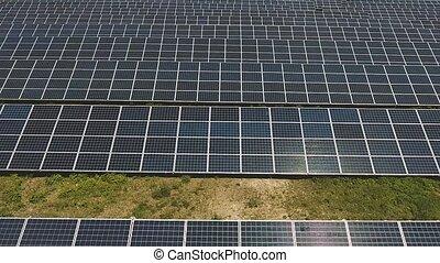 Solar panel units desert producing renewable energy - Aerial...
